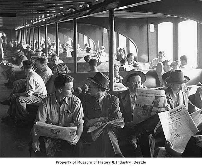 Keep clicking for historical photos of Washington's ferries... This photo shows passengers reading newspapers aboard the 'Kalakala' in 1951. Photo courtesy MOHAI, Seattle P-I Collection, image number 1986.5.13625.1.