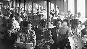This photo shows passengers reading newspapers aboard the 'Kalakala' in 1951. Photo courtesy MOHAI, Seattle P-I Collection, image number 1986.5.13625.1.