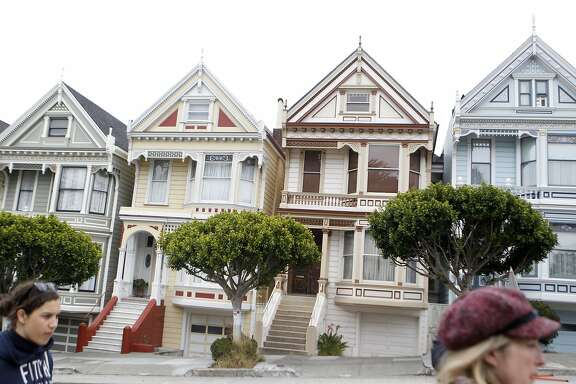 Tourist take photos of the Painted Ladies on Wednesday, June 8, 2016 in San Francisco, California. Alamo Square park is closed due to renovation but plan to open a section so that tourist can take better photo of the famous homes.