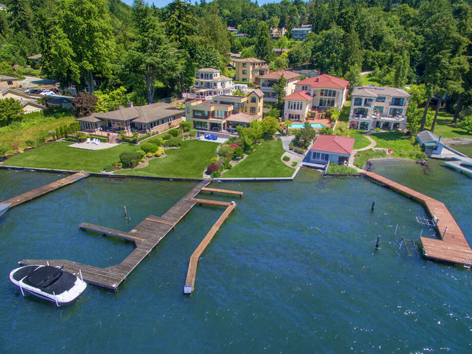 The first home on our mini Waterfront Home Tour is at 13245 Holmes Point Dr. N.E. The home is in Kirkland.The six-bedroom, 6½-bathroom home is listed for $5.25 million. The home features a massive theater room, a wine cellar, a large pool and a cabana.You can see the full listing here. Photo: Bryan Loveless, Windermere Real Estate Northeast Inc.