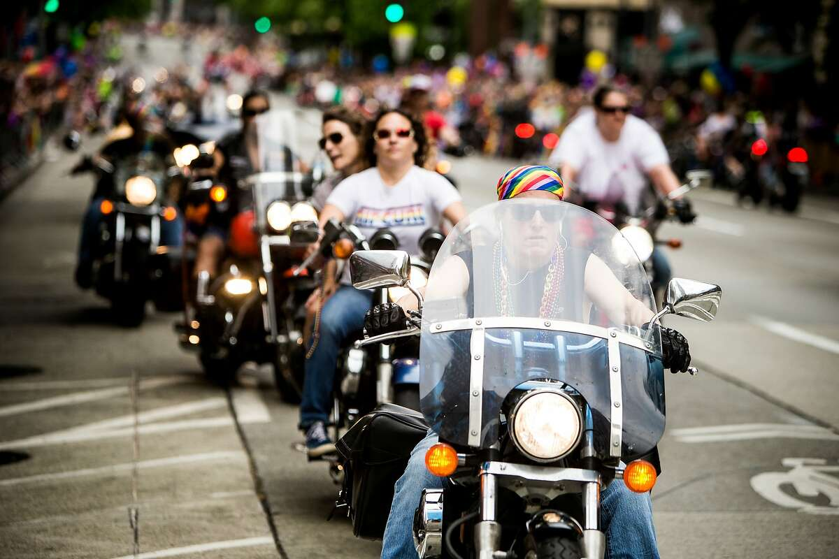 Dykes on Bikes lead off the 41st annual Pride Parade, photographed in Seattle, Washington.