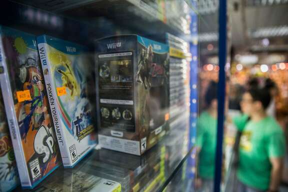 "Wii U gaming console game ""Pokken Tournament"" (L), with the Pikachu character from Nintendo's Pokemon franchise on the cover, is displayed in a counter of a computer games mall in Hong Kong on June 1, 2016.  Gaming fans in Hong Kong have called a decision ""absurd"" by Japan's Nintendo to rename the popular Pokemon character Pikachu using the official language of mainland China instead of local language Cantonese. / AFP PHOTO / ANTHONY WALLACEANTHONY WALLACE/AFP/Getty Images"