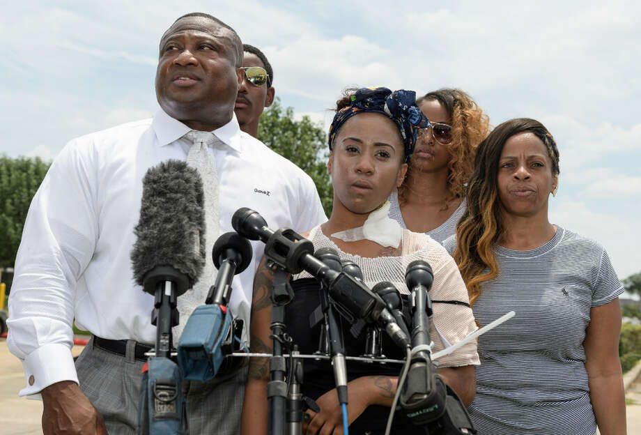 Haronisha Alexander addresses reporters with her family and Quanell X Wednesday, June 8, 2016at the 3155 S. Loop Freeway Taco Bell in southwest Houston.Alexander alleges Taco Bell employees threw hot cooking grease at her and boyfriend Johnson Moore during multiple fights on June 1, 2016. Photo: Wilf Thorne For The Houston Chronicle