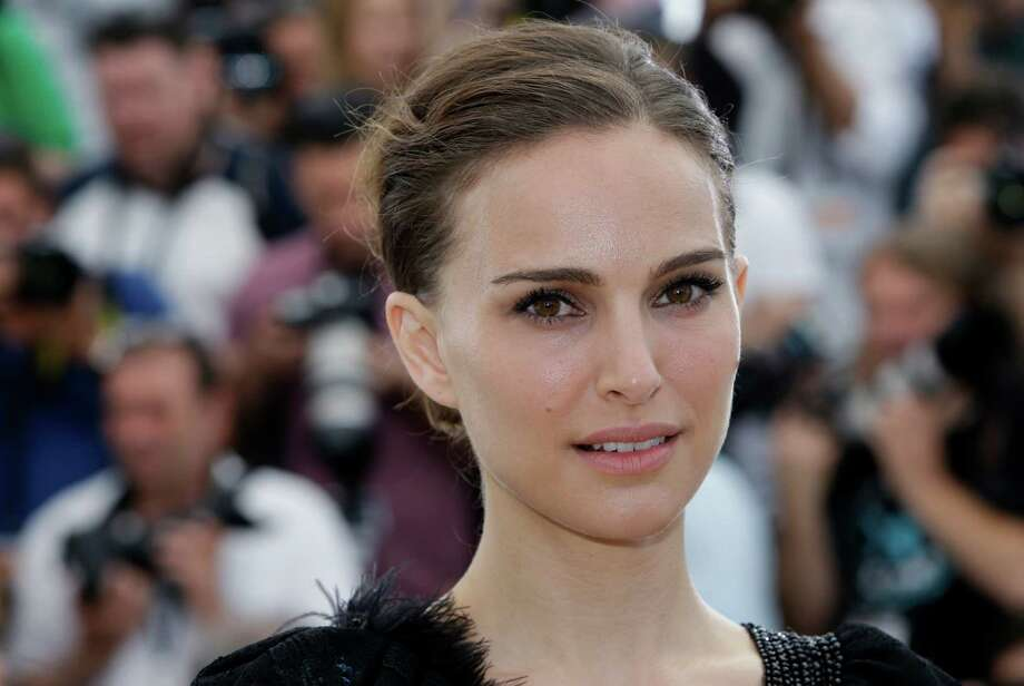 "FILE - In this May 17, 2015 file photo, Natalie Portman poses for photographers during a photo call for the film A Tale of Love and Darkness, at the 68th international film festival, Cannes, southern France. The Foo Fighters, Natalie Portman, U2 and other entertainers have canceled events in Paris following deadly terrorist attacks in the city Friday, Nov. 13, 2015. The Foo Fighters canceled the remaining dates of their European tour, including a planned show in Paris on Monday. Film distributor Mars said Saturday it had canceled promotional appearances for the film ""Jane Got a Gun"" starring Portman. (AP Photo/Lionel Cironneau) ORG XMIT: NY108 Photo: Lionel Cironneau / AP"
