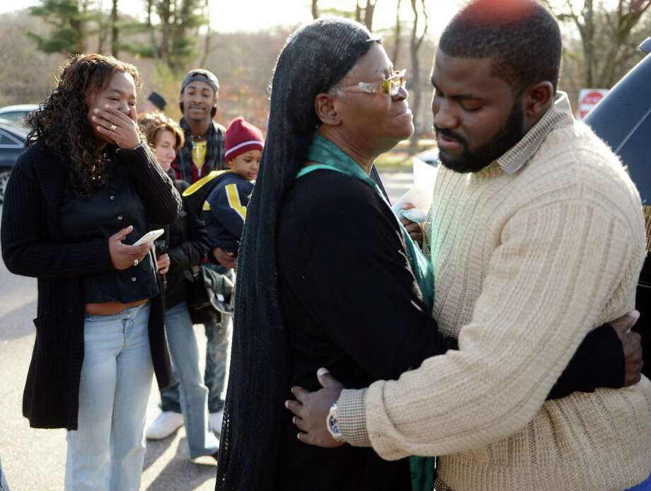 Bonnie Jean Foreshaw embraces Mike Jones, right, after answering questions from the media in a parking lot at Perez Park in East Lyme in 2013. Foreshaw 66, spent 27 years in prison for the murder of a pregnant woman, was released on Friday, four years early, after state officials took the rare step of granting her clemency. Foreshaw was sentenced to 45 years in prison for premeditated murder in the 1986 killing of a pregnant woman, Joyce Amos, in Hartford. The fetus didn't survive. Foreshaw argued she shot Amos by accident while defending herself against another person, a claim rejected by prosecutors. Foreshaw is only the second inmate in a decade to have a clemency application approved by the Board of Pardons and Paroles. (AP Photo/The Day, Sean D. Elliot) MANDATORY CREDIT Photo: SEAN D. ELLIOT / Associated Press / The Day