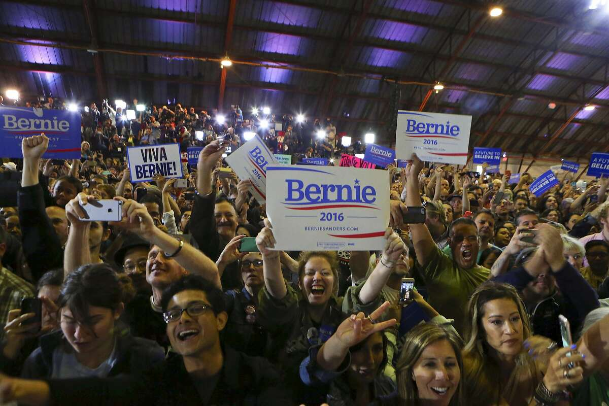 Supporters of Sen. Bernie Sanders cheer during an election night rally with Sanders at Barker Hangar in Santa Monica, Calif., June 7, 2016. With victories in four states, Hillary Clinton became the first woman to claim a major party�s presidential nomination, but Sanders refused to yield, insisting that he would continue his campaign. (Jim Wilson/The New York Times)