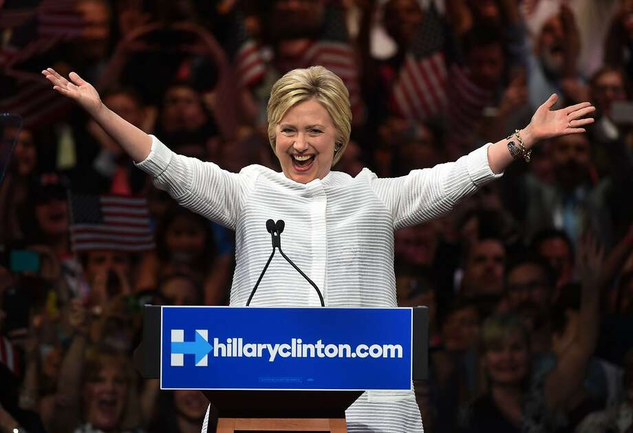 """Democratic presidential candidate Hillary Clinton celebrates on stage during her primary night event at the Duggal Greenhouse, Brooklyn Navy Yard, in New York, and hails a historic """"milestone"""" for women as she claims victory over rival Bernie Sanders. Photo: TIMOTHY A. CLARY, AFP/Getty Images"""