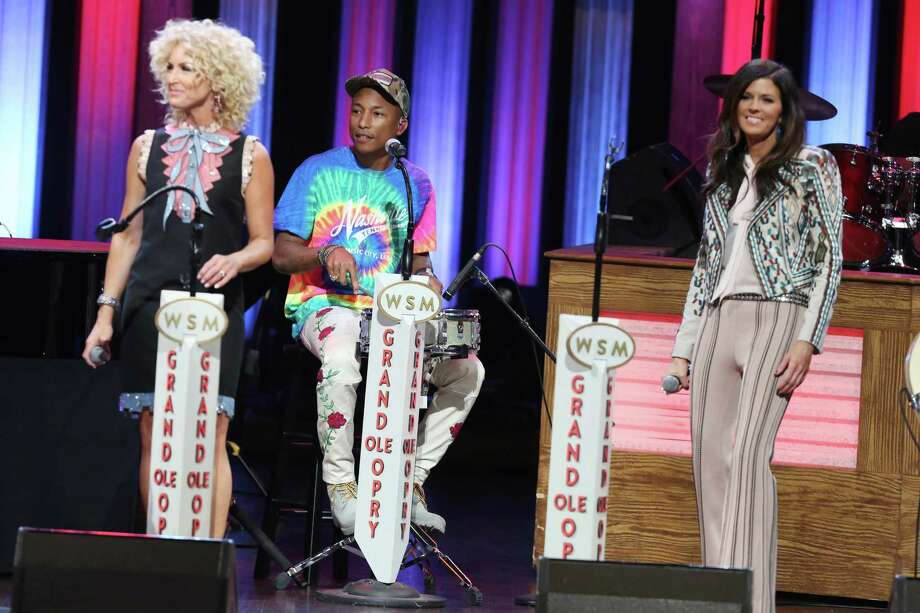 Pharrell Williams, center, performs with Kimberly Schlapman, left, and Karen Fairchild of Little Big Town at the Grand Ole Opry on Tuesday, June 7, 2016, in Nashville, Tenn. (Photo by Laura Roberts/Invision/AP) ORG XMIT: TNBR105 Photo: Laura Roberts / Invision