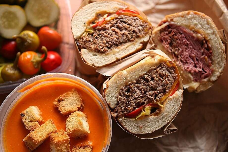 Tomato polenta soup, pickle tray and sandwiches at Deli Board in the SoMa area of S.F. Photo: Liz Hafalia, The Chronicle