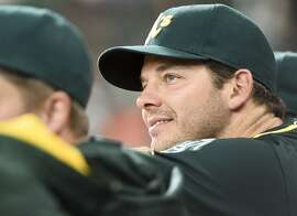 Oakland Athletics' pitcher Rich Hill watches from the dugout before a baseball game against the Houston Astros, Friday, June 3, 2016, in Houston. (AP Photo/Eric Christian Smith)