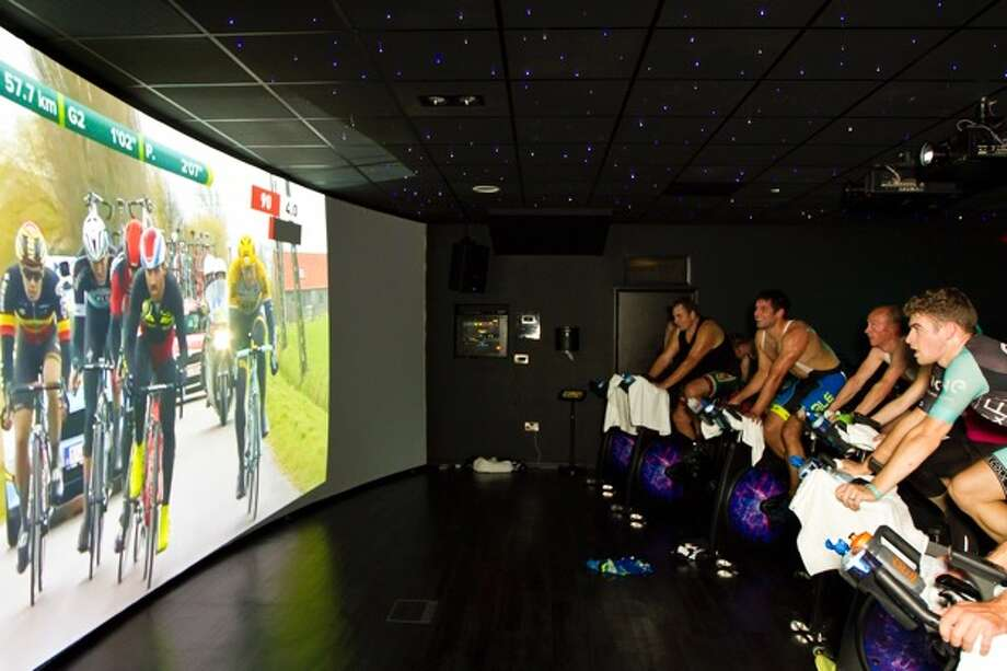 So you think you're Lance Armstrong, try the Sufferfest at Ascent Fitness on W. Alabama.  Photo: Sufferfest