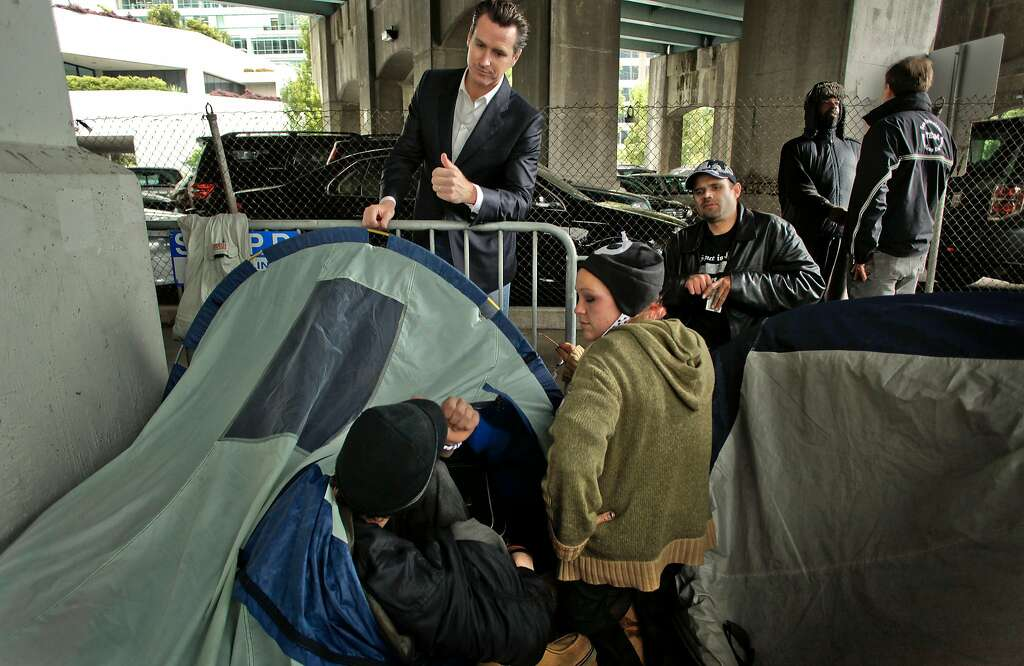 Mayor Gavin Newsom visits with homeless campers under the Transbay Terminal overpass on Beale Street in July 2010. Photo: Michael Macor / The Chronicle 2010