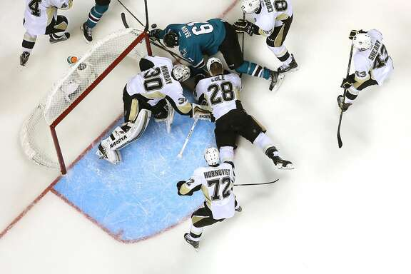 SAN JOSE, CA - JUNE 06: The Pittsburgh Penguins combine to stop Justin Braun #61 of the San Jose Sharks in Game Four of the 2016 NHL Stanley Cup Final at SAP Center on June 6, 2016 in San Jose, California.  The Penguins defeated the Sharks 3-1. (Photo by Ezra Shaw/Getty Images)