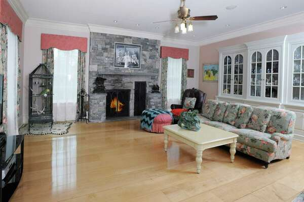 The living room with fireplace in this 3.35-acre gated estate at 2959 Congress St. in Fairfield.