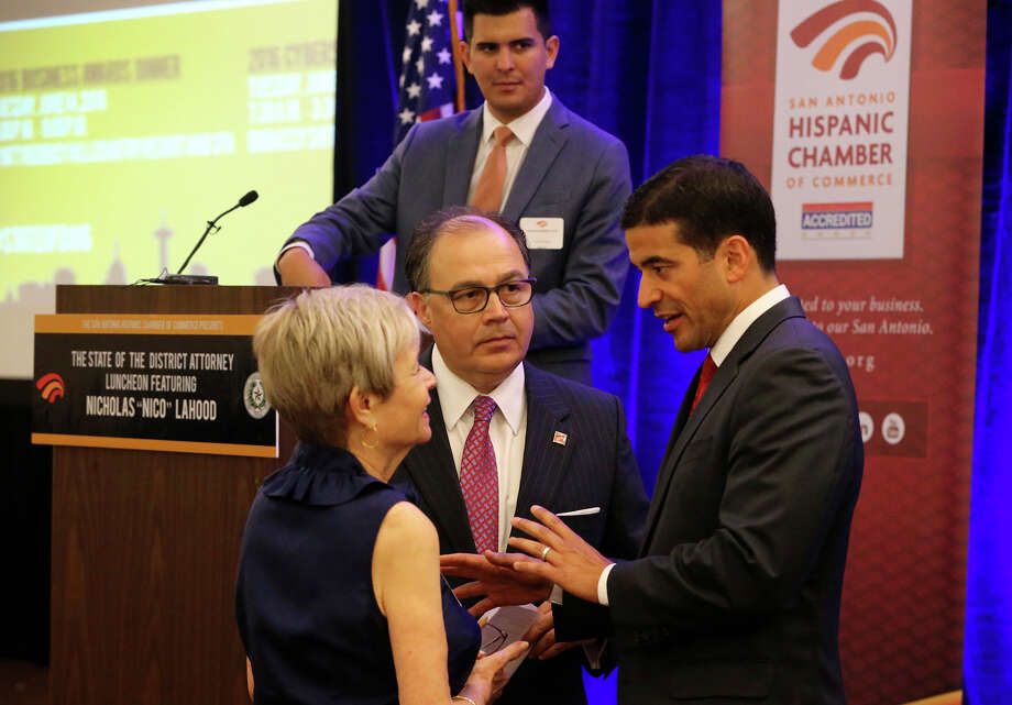 "Bexar County District Attorney Nicholas ""Nico"" LaHood (right) speaks Wednesday June 8, 2016 with Phyllis Siegel (left) and San Antonio Hispanic Chamber of Commerce President and CEO Ramiro A. Cavazos (center bottom) before LaHood presented his inaugural State of the District Attorney address at the Embassy Suites Riverwalk Hotel. LaHood gave an insider's perspective of the challenges and issues he and his staff have faced on a day-to-day basis. Photo: John Davenport,  Staff / San Antonio Express-News / ©San Antonio Express-News/John Davenport"