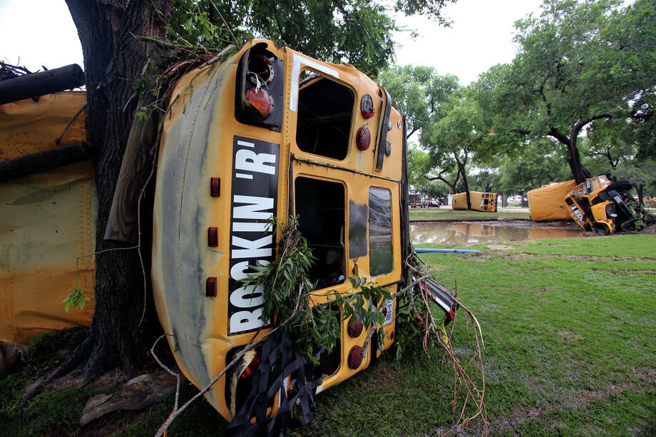 """Buses from Rockin' """"R"""" River Rides are wrapped around trees along the banks of the Guadalupe in Gruene. Flooding in New Braunfels on June 9, 2010. Tom Reel/Staff Photo: TOM REEL, STAFF / SAN ANTONIO EXPRESS-NEWS / © 2010 San Antonio Express-News"""