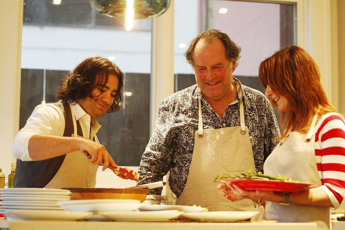 Lee Daniel Kravitz, Kurt Reinhard and Janis Cooke Newman prepare dinner for writers and other literary types on Tuesday, June 7,2016 in San Francisco, California. The dinner was French, based on one of her character's dream of going to Paris. Her book