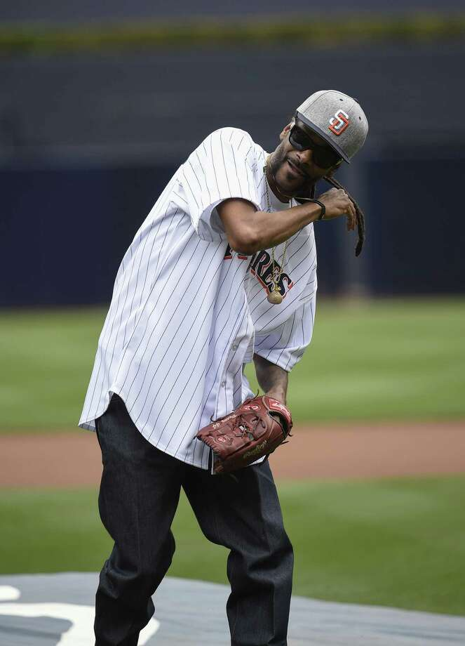 SAN DIEGO, CALIFORNIA - JUNE 8:  Snoop Dogg throws out the ceremonial first pitch before a baseball game between the San Diego Padres and the Atlanta Braves at PETCO Park on June 8, 2016 in San Diego, California. Photo: Denis Poroy, Getty Images / 2016 Getty Images