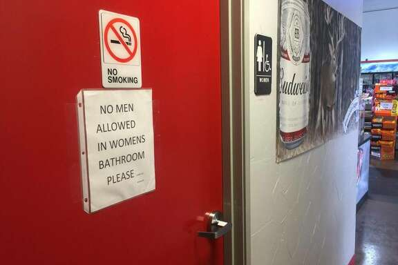 A sign on the women's bathroom door at the Texaco Station and BBQ on the Brazos restaurant seems to make clear the owner's stance on the transgender restroom issue.   Courtesy photo from the Fort Worth Star-Telegram