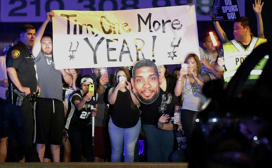 Fans who welcomed the Spurs home after they were eliminated by the Thunder in the Western Conference semifinals don't want Tim Duncan to be the retiring sort. Photo: Kin Man Hui, Staff / ©2016 San Antonio Express-News