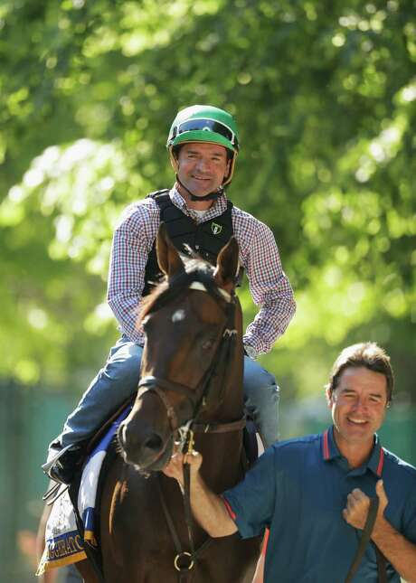 Jockey Kent Desormeaux and trainer Keith Desormeaux lead Exaggerator onto the track before a training session for the Belmont. Photo: Al Bello, Staff / 2016 Getty Images