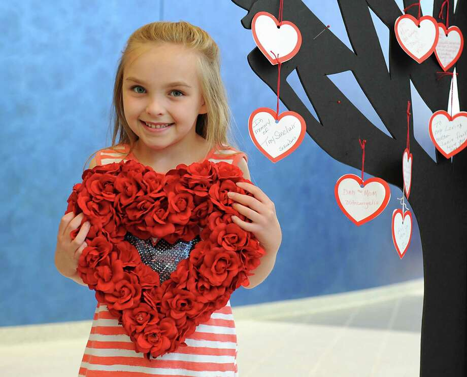 Eliana Clem, 7, the Heart Princess at this year's Heart Walk, holds a heart at New York State United Teachers on Tuesday, June 7, 2016 in Latham, N.Y. Eliana was born with a heart defect that was fixed by a local surgeon, Dr. Devejian. The Heart Walk is hosted by the American Heart Association. (Lori Van Buren / Times Union) Photo: Lori Van Buren / 40036864A