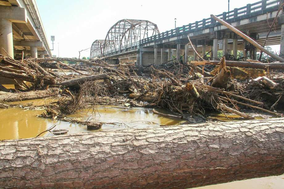 Flood debris clogs the San Jacinto River West Fork channel and what once was a boat ramp beneath the Highway 59 bridge. Photo: Shannon Tompkins