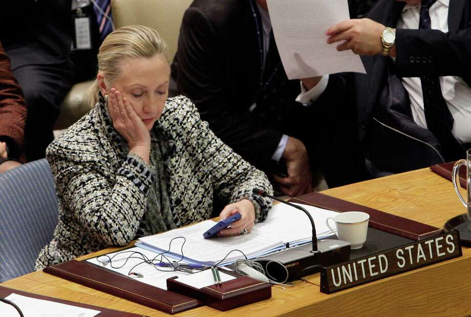 FILE - In this March 12, 2012 file photo, then-Secretary of State Hillary Rodham Clinton checks her mobile phone after her address to the Security Council at United Nations headquarters. Photo: Richard Drew, STF / AP2012