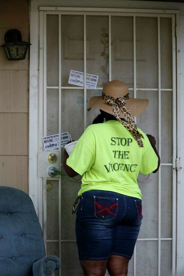A member of the San Antonio Metropolitan Health District's violence prevention program, Stand Up S.A., places informational cards at the house where five-year-old Ana Garza lived on the 800 block of Pecan Valley, Wednesday, June 8, 2016. Garza and her relative, Carlos Aguilar, were shot on June 1 at the house. She died today.  The young girl was asleep in the house when the shooting occurred and a bullet hit her on the head. Photo: Jerry Lara, San Antonio Express-News / © 2016 San Antonio Express-News