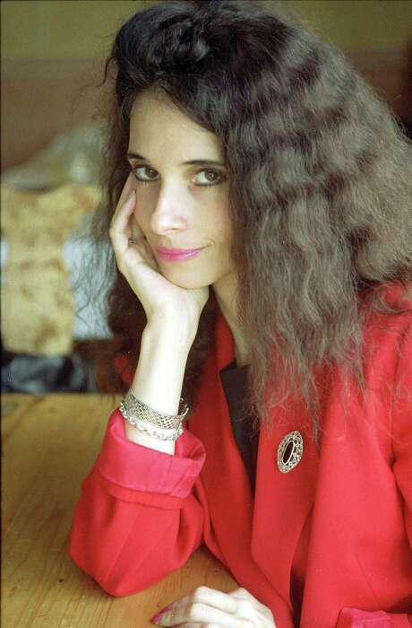 """FILE - In this July 1992 file photo, actress Theresa Saldana, co-star of the ABC series """"The Commish,"""" poses for a portrait in Los Angeles. Saldana, the """"Raging Bull"""" actress who survived a stalker's brutal attack to become a crime victim's advocate and reclaimed her entertainment career with """"The Commish"""" and other TV shows, has died Monday, June 6, 2016. She was 61. (AP Photo/Chris Martinez, File) Photo: Chris Martinez, STF / AP"""
