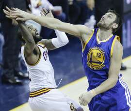 Cleveland Cavaliers' Kyrie Irving watches his shot over Golden State Warriors' Andrew Bogut in the first quarter during Game 3 of the NBA Finals at The Quicken Loans Arena on Wednesday, June 8, 2016 in Cleveland, Ohio