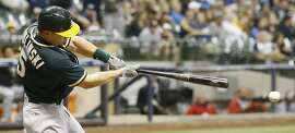 Oakland Athletics' Jake Smolinski hits a single during the sixth inning of a baseball game against the Milwaukee Brewers Wednesday, June 8, 2016, in Milwaukee. The hit was the Athletics' first of the game. (AP Photo/Morry Gash)