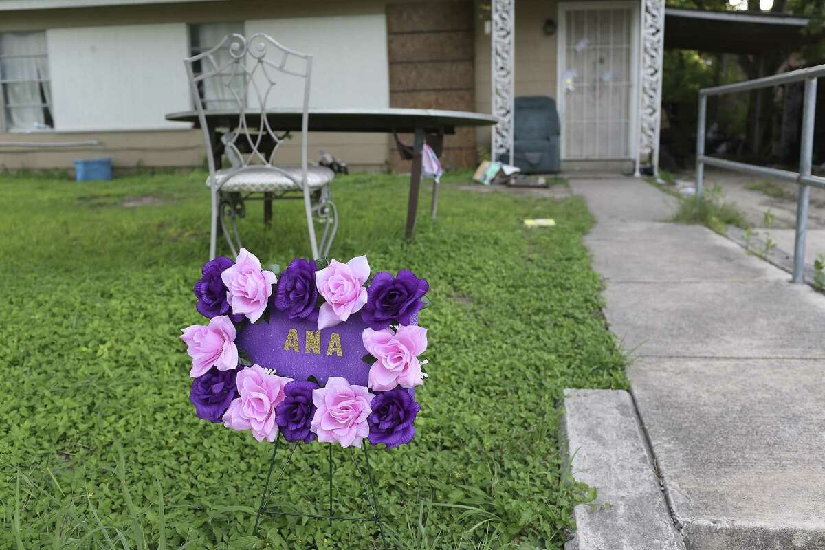 A neighbor placed a wreath in front of the house where 5-year-old Ana Garza lived in the 800 block of Pecan Valley on June 8, 2016, the day the girl died after she and her relative, Carlos Aguilar, were shot on June 1 at the house.