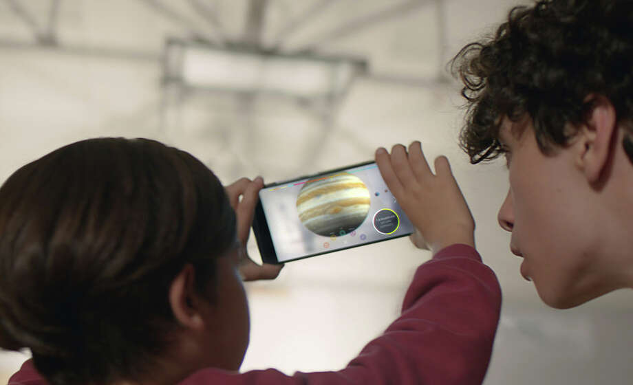 Earthlings look over the solar system using technology from Project Tango. Tango, which is a bid to create machines with a better sense of what's around them, uses software and sensors to track motions and size up the contours of rooms. Photo: HONS / Google
