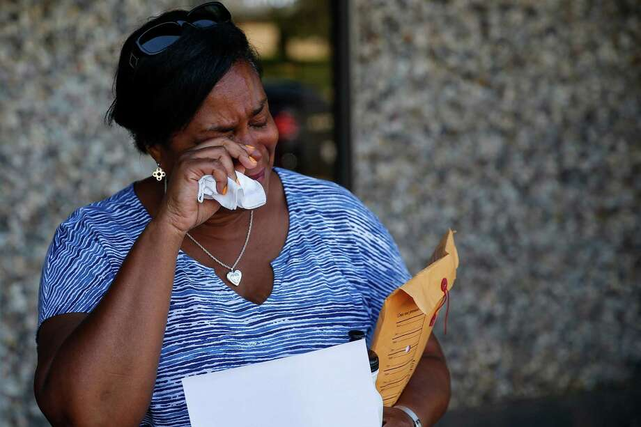 Sheila Muldrow as she attempts to fill out paperwork to have her son, Warren Muldrow, 22, taken to a hospital on a mental health warrant Tuesday, June 7, 2016 in Sugar Land. Muldrow became overwhelmed when was told she was in the wrong precinct to file the warrant for her son who has struggled with mental health and drug problems for years. ( Michael Ciaglo / Houston Chronicle ) Photo: Michael Ciaglo, Staff / © 2016  Houston Chronicle