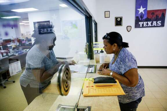 Sheila Muldrow, right, speaks to a court employee at the Fort Bend County Justice of the Peace as she fills out paperwork to have her son, Warren Muldrow, 22, taken to a hospital on a mental health warrant Tuesday, June 7, 2016 in Missouri City. ( Michael Ciaglo / Houston Chronicle )