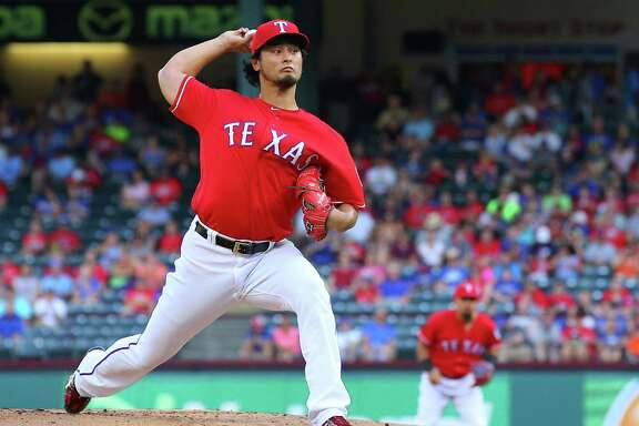 ARLINGTON, TX - JUNE 08: Yu Darvish #11 of the Texas Rangers throws in the first inning against the Houston Astros at Globe Life Park in Arlington on June 8, 2016 in Arlington, Texas.