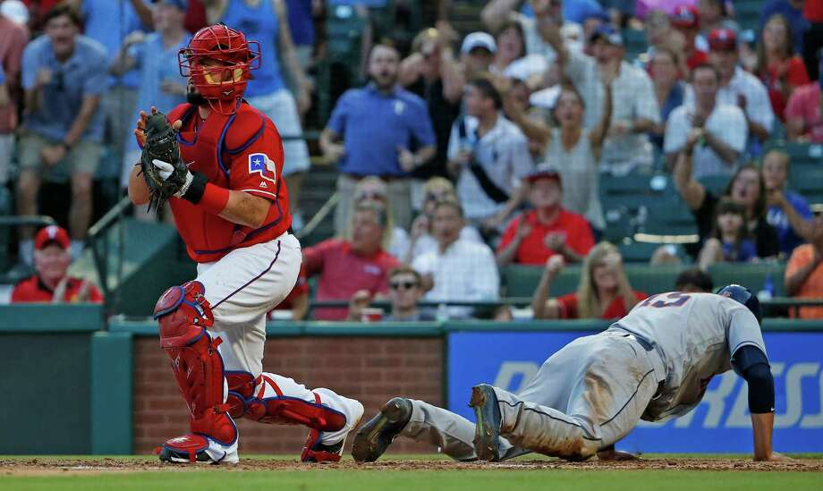 The Houston Astros' Jason Castro, right, is out at home after a collision with Texas Rangers catcher Bobby Wilson in the third inning at Globe Life Park in Arlington, Texas, on Wednesday, June 8, 2016. Photo: Paul Moseley, TNS / Fort Worth Star-Telegram