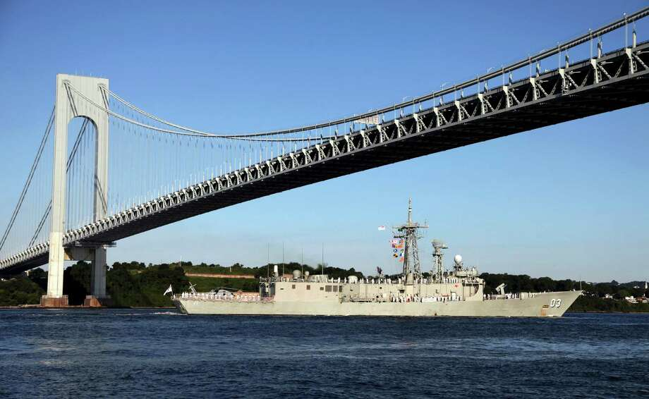 FILE- In this July 19, 2009 file photo, the Australian naval frigate HMAS Sydney passes under the Verrazano-Narrows Bridge as it enters New York Harbor. For over 50 years, the Metropolitan Transportation Authority has spelled the name of the bridge with a single z, but the Italian Italian explorer Giovanni da Verrazzano, whom the bridge is named after, spelled his name with two z's. (AP Photo/Craig Ruttle, File) ORG XMIT: NYR102 Photo: Craig Ruttle / AP2009