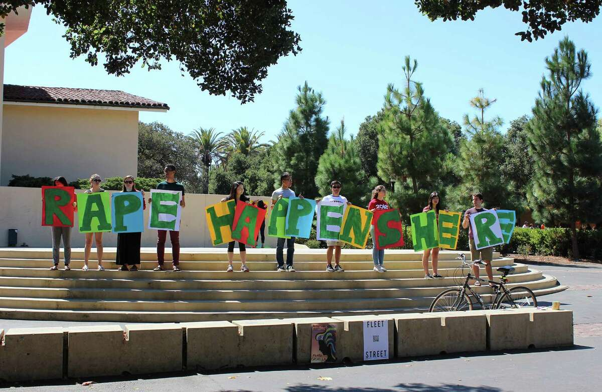 In this Sept. 16, 2015 photo provided by Tessa Ormenyi, students hold up a sign about rape at White Plaza during New Student Orientation on the Stanford University campus in Stanford, Calif. Stanford University considers itself a national leader on preventing and handling sexual assaults, but students have complained that the school isn't doing enough and have drawn attention to the issue by holding demonstrations. (Tessa Ormenyi via AP) MANDATORY CREDIT ORG XMIT: FX105