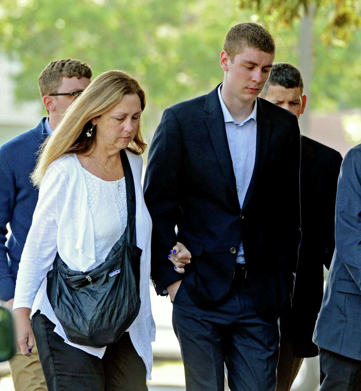 FILE - In this June 2, 2016 file photo, Brock Turner, right, makes his way into the Santa Clara Superior Courthouse in Palo Alto, Calif. A letter written by Turner's father was made public over the weekend by a Stanford law professor who wants the judge in the case removed from office because Brock Turner's sentencing. (Dan Honda/Bay Area News Group via AP, File) MAGS OUT NO SALES ORG XMIT: CAJOS201