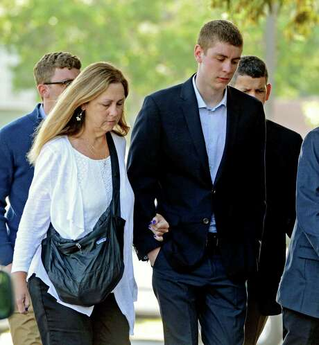 FILE - In this June 2, 2016 file photo, Brock Turner, right, makes his way into the Santa Clara Superior Courthouse in Palo Alto, Calif. A letter written by Turner's father was made public over the weekend by a Stanford law professor who wants the judge in the case removed from office because Brock Turner's sentencing. (Dan Honda/Bay Area News Group via AP, File) MAGS OUT NO SALES ORG XMIT: CAJOS201 Photo: Dan Honda / Bay Area News Group