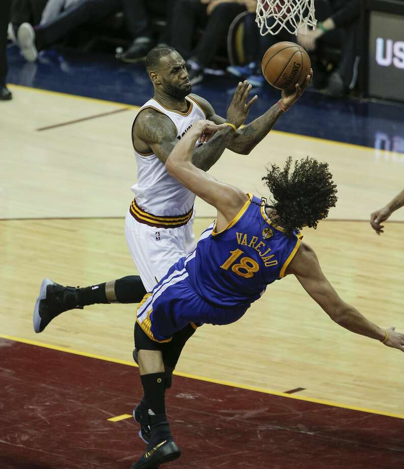 Anderson Varejao tumbles as LeBron James drives to the hole during the NBA finals. Photo: Carlos Avila Gonzalez, The Chronicle
