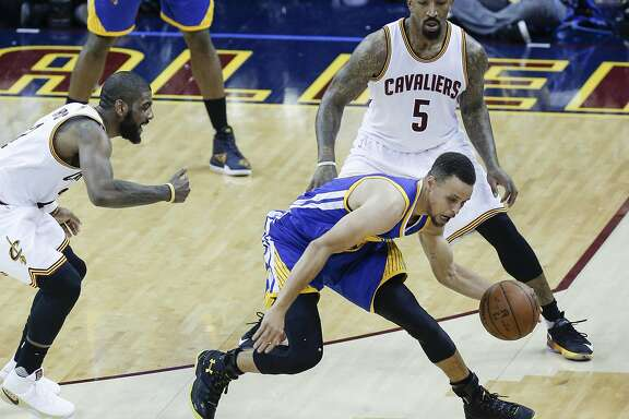 Golden State Warriors' Stephen Curry regains control of the ball in the third quarter after Cleveland Cavaliers' Kyrie Irving knocked the ball away during Game 3 of the NBA Finals at The Quicken Loans Arena on Wednesday, June 8, 2016 in Cleveland, Ohio.