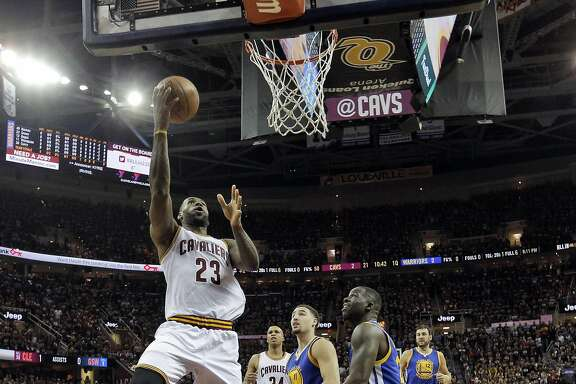 Lebron James (23) takes it to the hoop in the first half as the Golden State Warriors played the Cleveland Cavaliers in Game 3 of the NBA Finals at Quicken Loans Arena in Cleveland, Ohio, on Wednesday, June 8, 2016.