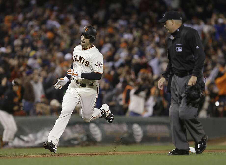 Mac Williamson circles the bases on a home run that gave the Giants a 2-1 lead in the eighth. It was his first of the season. Photo: Ben Margot, Associated Press