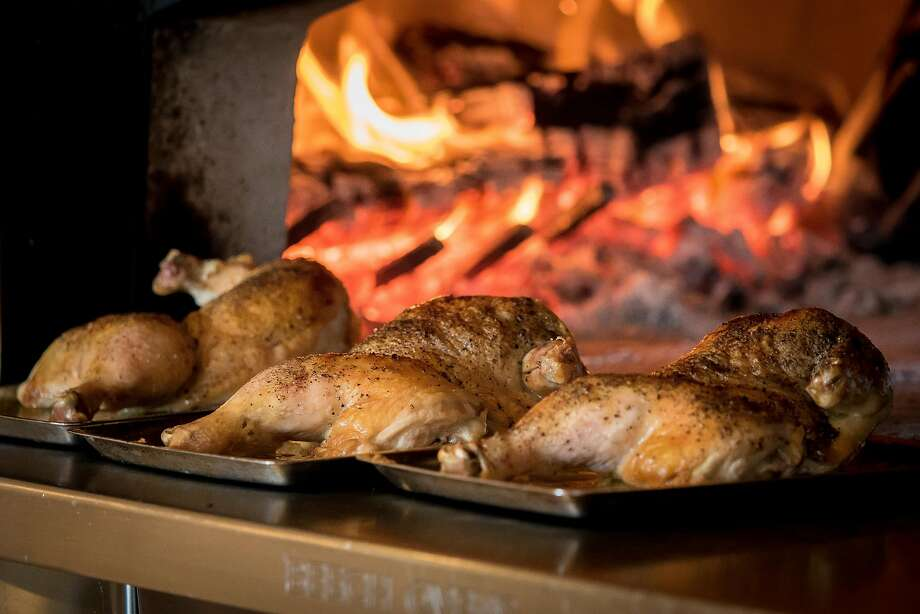 The JW Chicken in the wood-fired oven at Waxman's in S.F.'s Ghirardelli Square. Photo: John Storey, Special To The Chronicle