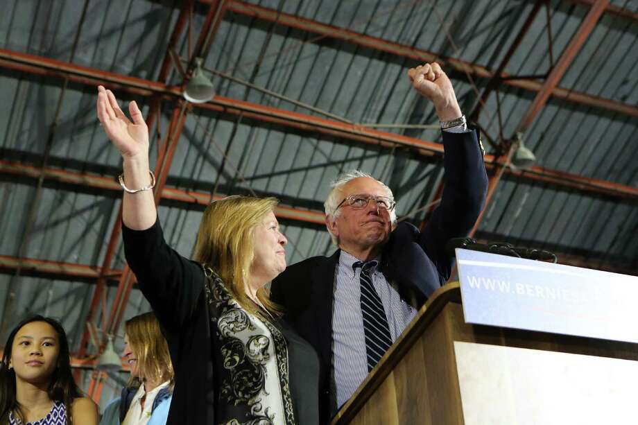 Sen. Bernie Sanders and his wife, Jane, after he spoke at a primary night rally at Barker Hangar in Santa Monica, Calif., Tuesday. Hillary Clinton's primary successes on Tuesday mutes the lingering argument for Bernie Sanders to stay in the race. Photo: JIM WILSON /NYT / NYTNS