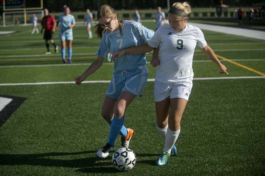 Traverse City Liberty's Angie Polomsy, left, and Freeland High School's Sarah Kretz fight for possession of the ball in the second half of the game on Wednesday in Clare. Freeland defeated TC Liberty 4-1. Photo: Brittney Lohmiller/Midland Daily News