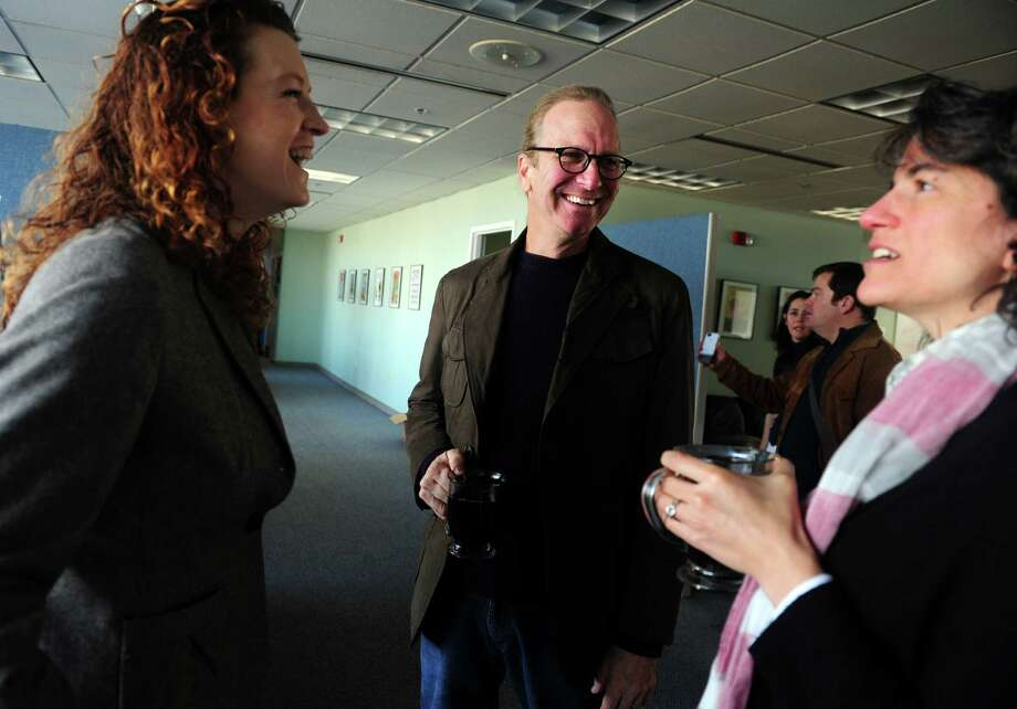 Chef Michel Nischan, CEO, founder and president of Wholesome Wave, talks with staff members Skye Cornell, left, and Sharon Hametz at the nonprofit's downtown Bridgeport office in 2012. Photo: File Photo / Connecticut Post